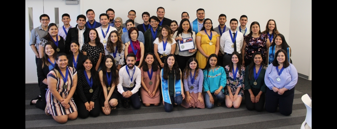 group photo of graduating scholars with medals